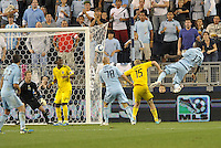 Sporting KC forward C.J Sapong has a header on goal... Sporting Kansas City defeated Columbus Crew 2-1 at LIVESTRONG Sporting Park, Kansas City, Kansas.