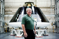Senior Manager of Mechanical Engineering for Lockheed Martin Space Systems and the Orion MPCV Program Paul Sannes (cq) stands with the Orion Multi-Purpose Crew Vehicle at Lockheed Martin in Denver, Colorado, Tuesday, June 7, 2011. The MPCV will serve as the exploration vehicle that will carry the crew to space, provide emergency abort capability, sustain the crew during the space travel, and provide safe re-entry from deep space return velocities..Photo by Matt Nager