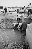 Culiacan, Mexico<br /> June 13, 2007<br /> <br /> A drug related execution, adding to the more then 300 this year in Cuilacan. Francisco de Jes&uacute;s Ibarra, 33 was found lying in a canal on the outskirts of San Pedro. He had been beaten and shot in the head.
