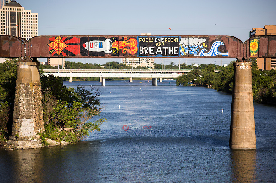 "Cool street art around Austin is not limited to sides of buildings, but also bridges as the Austin Railroad Graffiti Bridge over Lady Bird Town Lake contains famous pop-art graffiti paintings like the ""Focus One Point And Breathe"" mural in downtown Austin, Texas."
