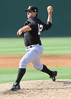 Pitcher Nick McCully (12) of the Kannapolis Intimidators, Class A affiliate of the Chicago White Sox, in a game against the Greenville Drive on May 27, 2011, at Fluor Field at the West End in Greenville, S.C. Photo by Tom Priddy / Four Seam Images