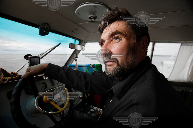 Captain Alexander Udenka navigates a passenger hydrofoil along the Amur River from the Russian Khabarovsk city to the Chinese Fuyuan city. Amur separates Russia and China.