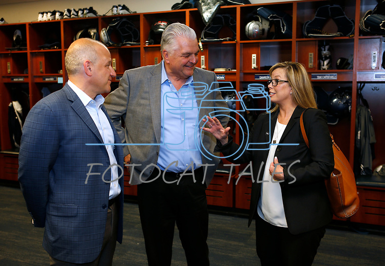 From left, Raiders president Marc Badain, Democratic governor candidate Steve Sisolak and Reno Mayor Hillary Schieve talk during a tour of the University of Nevada, Reno athletic facilities in Reno, Nev., on Thursday, Aug. 16, 2018. The Raiders are considering several potential training camp locations in Reno. (Cathleen Allison/Las Vegas Review-Journal)