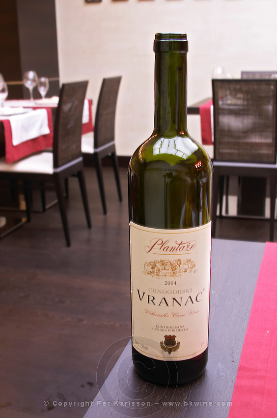 Bottle of Plantaze Cnogorski Vranac Vrhunsko Crno Vino red wine in the restaurant Stara Kuca Podgorica capital. Montenegro, Balkan, Europe.