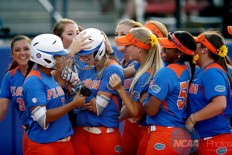 02 JUNE 2014:   Aubree Munro (1) of the University of Florida hits a home run against the University of Alabama during the Division I Women's Softball Championship held at ASA Hall of Fame Stadium in Oklahoma City, OK.  Shane Bevel/NCAA Photos