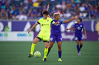 Orlando, Florida - Sunday, May 8, 2016: Orlando Pride midfielder Lianne Sanderson (10) looks for a call after Seattle Reign FC midfielder Keelin Winters (11) takes the ball away during a National Women's Soccer League match between Orlando Pride and Seattle Reign FC at Camping World Stadium.