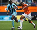 Matthew Barnes-Homer of Luton holds off Brian Saah of Cambridge United during the Blue Square Bet Premier match between Luton Town and Cambridge United at Kenilworth Road, Luton  on 11th September 2010.© Kevin Coleman 2010