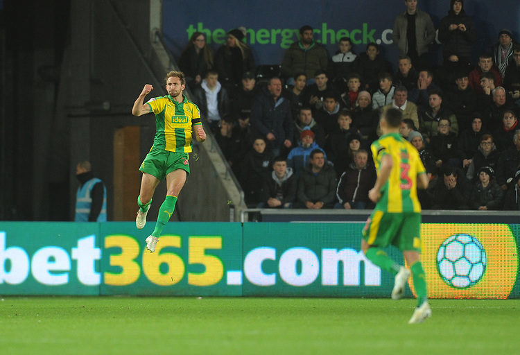 West Bromwich Albion's Craig Dawson celebrates scoring his side's equalising goal to make the score 1-1<br /> <br /> Photographer Kevin Barnes/CameraSport<br /> <br /> The EFL Sky Bet Championship - Swansea City v West Bromwich Albion - Wednesday 28th November 2018 - Liberty Stadium - Swansea<br /> <br /> World Copyright &copy; 2018 CameraSport. All rights reserved. 43 Linden Ave. Countesthorpe. Leicester. England. LE8 5PG - Tel: +44 (0) 116 277 4147 - admin@camerasport.com - www.camerasport.com