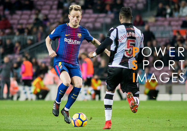 Ivan Rakitic (L) of FC Barcelona competes for the ball with Cheik Doukoure of Levante UD  during the La Liga 2017-18 match between FC Barcelona and Levante UD at Camp Nou on 07 January 2018 in Barcelona, Spain. Photo by Vicens Gimenez / Power Sport Images