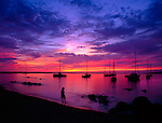 Sunset over a boat harbor on the Big Island, Hawaii
