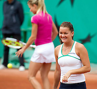 Agnieszka Radwanska (POL) & Maria Kirilenko (RUS) (11) against Petra Kvitova (CZE) & Stefanie Voegele (SUI) in the second round of the women's doubles. Radwanska & Kirilenko beat Kvitova & Voegele 6-1 5-7 6-3..Tennis - French Open - Day 7 - Say 30 May 2010 - Roland Garros - Paris - France..© FREY - AMN Images, 1st Floor, Barry House, 20-22 Worple Road, London. SW19 4DH - Tel: +44 (0) 208 947 0117 - contact@advantagemedianet.com - www.photoshelter.com/c/amnimages