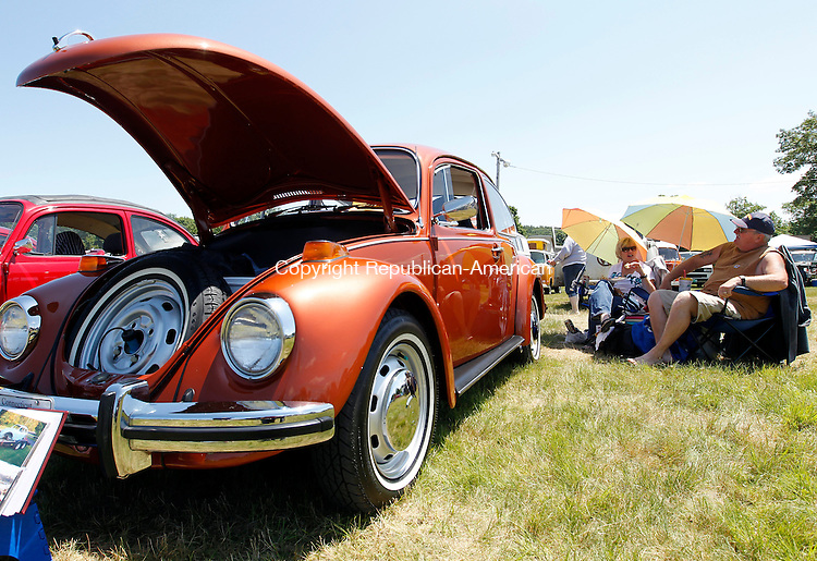 Harwinton, CT-17 June 2012-061712CM02-  Karen (left) and Jeffrey Miller of Northford (outside New Haven) enjoy lunch next to their 1973 Beetle Standard during of the 23rd Annual Litchfield Bug-In Volkswagen Car Show Sunday afternoon at the Harwinton Fair Grounds. Both Miller's restored the Bug, adding their first car when they got married was Volkswagen.   The show is the major fundraiser for the Bronc Callahan Community Fund with all proceeds going to the Community Fund.  The event featured food, refreshments vendors and awards.   Christopher Massa Republican-American