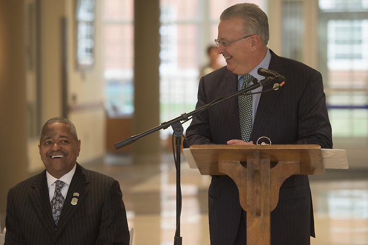 David Wolfort, Chair of the Ohio University Board of Trustees, right, delivers the welcome address during the ribbon cutting ceremony for the Gladys W. and David H. Patton College of Education's newly renovated McCracken Hall held on January 27, 2017.