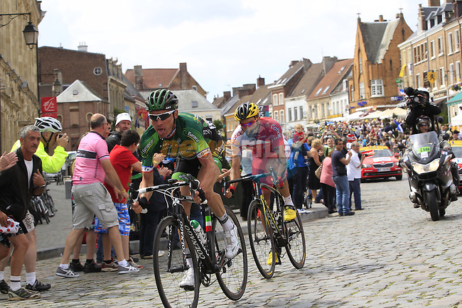 The breakaway Thomas Voeckler (FRA) Team Europcar and Luis Angel Mate Mardones (ESP) Cofidis pass through the ancient town of Cassel during Stage 4 of the 2014 Tour de France running 163.5km from Le Touquet to Lille. 8th July 2014.<br /> Picture: Eoin Clarke www.newsfile.ie