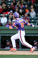 Left fielder Reed Rohlman (26) of the Clemson Tigers bats in the Reedy River Rivalry game against the South Carolina Gamecocks on Saturday, February 28, 2015, at Fluor Field at the West End in Greenville, South Carolina. South Carolina won, 4-1. (Tom Priddy/Four Seam Images)