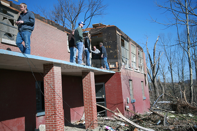 People standon the second floor of their house near Hospital Hill, outside West Liberty, Ky. March 3, 2012. Photo by Brandon Goodwin | Staff