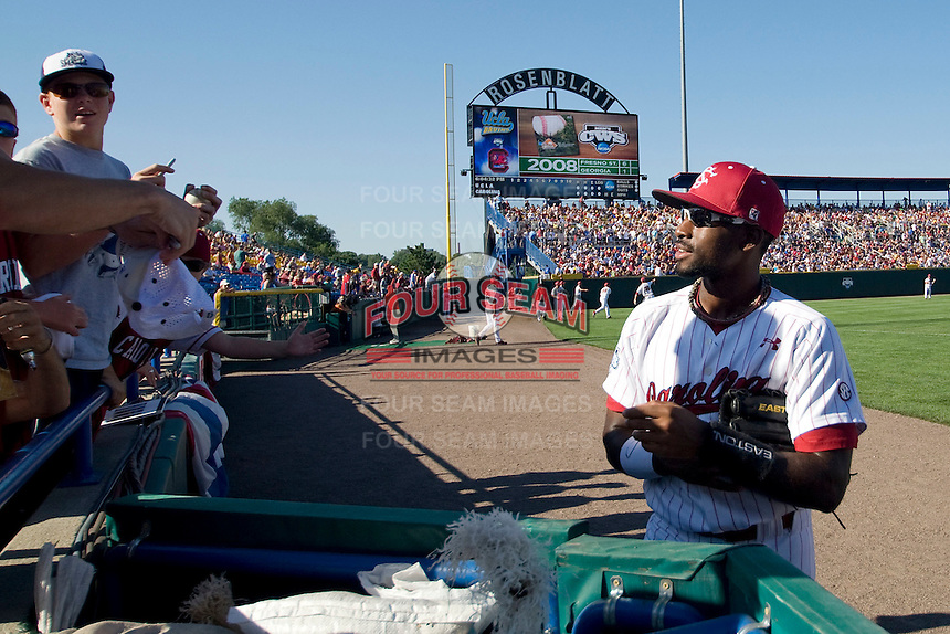 South Carolina CF Jackie Bradley Jr chats with some fans before Game Two of the NCAA Division One Men's College World Series Finals on June 29th, 2010 at Johnny Rosenblatt Stadium in Omaha, Nebraska.  (Photo by Andrew Woolley / Four Seam Images)