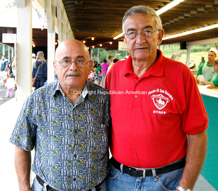 Waterbury, CT- 10 August 2013-080113CM08- SOCIAL MOMENTS, left to right, Giovanni Daddona, of Oakville and Nunzio Mancini of Waterbury  during the opening night of the 27th annual Festa di San Donato at the Pontelandolfo Community Club in Waterbury Thursday night.    Christopher Massa Republican-American