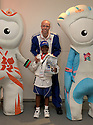 05/08/12 ***FREE PHOTO FOR EDITORIAL USE***..Joined by Olympic mascots Wenlock and Mandeville, Decathlon Olympian, Dean Macey gives Shantasia Morris, her gold Mascotathon medal at the prize winning ceremony at the United States Olympics Committee, Royal College of Art, London...Twenty winners of the McDonald's Mascotathon competition won a once-in-a-lifetime back-stage experience to London 2012. ..They received five star treatment during their three-day, all expenses paid trip to the world's biggest sporting event this year..