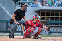 Lehigh Valley IronPigs catcher Logan Moore (11) sets a target as home pate umpire Shane Livensparger looks on during the game against the Charlotte Knights at BB&T BallPark on May 30, 2015 in Charlotte, North Carolina.  The IronPigs defeated the Knights 1-0.  (Brian Westerholt/Four Seam Images)