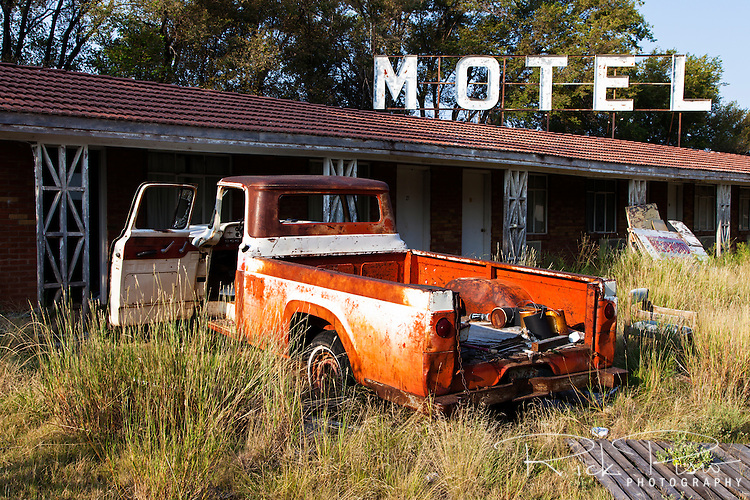 An abandoned truck in the Paradise Motel parking lot on Route 66 on the west side of Tucumcari, New Mexico.