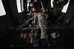"Scenes from the medical evacuations of wounded Americans, Canadians, and Afghan civilians and soldiers being flown by Charlie Co. 6th Battalion 101st Aviation Regiment of the 101st Airborne Division. Charlie Co. - which flies under the call-sign ""Shadow Dustoff"" - flies into rush the wounded to medical care out of bases scattered across Oruzgan, Kandahar, and Helmand Provinces in the Afghan south. These images were taken of missions flown out of Camp Dwyer in Helmand Province."