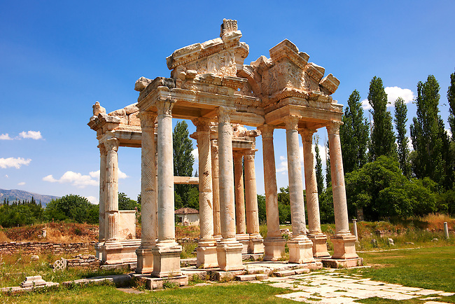 "Picture of the double Tetrapylon Gate, Aphrodisias, Turkey. A tetrapylon (Greek: Τετράπυλον, ""four gates"") is an ancient type of Roman monument of cubic shape, with a gate on each of the four sides: generally it was built on a crossroads. stock photos & photo art prints. 7"