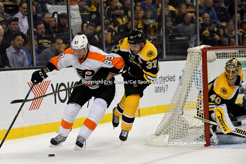 Wednesday, October 21, 2015: Philadelphia Flyers right wing Jakub Voracek (93) battles Boston Bruins center Patrice Bergeron (37) for the puck as goalie Tuukka Rask (40) guards the net during the National Hockey League game between the Philadelphia Flyers and the Boston Bruins, held at TD Garden, in Boston, Massachusetts. The Flyers defeat the Bruins 5-4 in overtime. Eric Canha/CSM