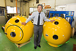 (File Photo) Hiratsuka, Japan - In the file photo released on November 25, 2011 shows Shoji Tanaka, 66, Chief Executive Officer of Cosmo Power Co., Ltd., standing between two Noah's Ark safety capsules in his company factory in Hiratsuka, Kanagawa Prefecture, October 20, 2011. Shoji came up with the idea to make Noah's Ark after watching the torrential rain that hit Kyushu approximately 4 years ago. His primary vision for the company is to make products that can save as many people in the future from large natural disasters. The construction process to fully complete a single capsule takes one day but the company aims to make 20 per day. There are currently two models of the safety capsules that can fit up to 4 people (1,200mm) (priced at 315,000 Japanese Yen) and 6 people (1,500mm) (priced at 471,450 Japanese Yen). There has been a demand of buyers for Noah's Ark from countries such as the United States, Brazil, China, Thailand, Bangladesh and New Zealand, however, the company is not ready to sell overseas at present. Shoji mentioned that he plans to make a more advanced model of Noah's Ark in the near future. (Photo by: Christopher Jue/AFLO)
