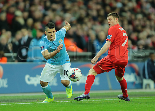 28.02.2016. Wembley Stadium, London, England. Capital One Cup Final. Manchester City versus Liverpool. Manchester City Forward Sergio Agüero gets past Liverpool Midfielder James Milner