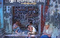 Myanmar street scenes in 1996 Repair shop in 1996 Yangon.