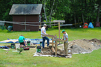 HAZLETON, PA - JUNE 30: Mike Roller (R) and two high school students work at the site of an archaeologic dig June 30, 2014 in Hazleton, Pennsylvania. The team is looking through sites connected with the Lattimer Massacre which occurred in 1897. (Photo by William Thomas Cain/Cain Images)