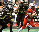 SIOUX FALLS, SD - JUNE 23:  Chris Dixon #2 from the Sioux Falls Storm runs past the defense including Marvin Johnson #3 from the Lee Valley Steelhawks in the first quarter of their first round playoff game Saturday night at the Sioux Falls Arena. (Photo by Dave Eggen/Inertia)