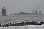 "MV ""Arklow Raider"" aground at the mouth of the river boyne, Attempts to refloat the 4505 Tonnes General Cargo Vessel at high tide this morning were unsucessfull after the vessel ran aground in high winds topping force 8 while it was leaving Drogheda Port with a cargo of Cement on Tuesday Night. Drogheda Port Companys MV Boyne Protector"" assisted in trying to  refloat the vessel, as 3 meter seas crashed into the side pushine the vessel further north towards the beach at Baltray. Th eIrish Coast Guard helicopter circuled over head as the tide went out ...Picture Fran Caffrey/www.newsfile.ie.."