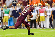 Blacksburg, VA - OCT 6, 2018: Virginia Tech Hokies running back Steven Peoples (32) breaks a tackle on his way to a first down during first  half action of game between Notre Dame and Virginia Tech at Lane Stadium/Worsham Field Blacksburg, VA. (Photo by Phil Peters/Media Images International)