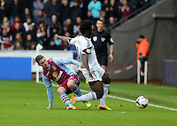 Sunday, 26 April 2014<br /> Pictured L-R Matthew Lowton of Aston Villa fouls Wilfried Bony of Swansea. <br /> Re: Barclay's Premier League, Swansea City FC v Aston Villa at the Liberty Stadium, south Wales.