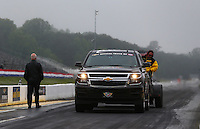 May 19, 2014; Commerce, GA, USA; NHRA Safety Safari member uses a jet dryer to dry the starting line area as official Graham Light (left) looks on during the Southern Nationals at Atlanta Dragway. Mandatory Credit: Mark J. Rebilas-USA TODAY Sports