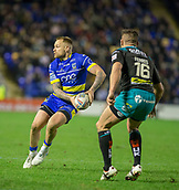 2nd February 2019, Halliwell Jones Stadium, Warrington, England; Betfred Super League rugby, Warrington Wolves versus Leeds Rhinos; Blake Austin passes his way around Brett Ferres