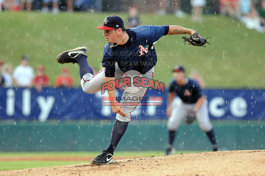 RHP Chris Balcom-Miller (19) of the Asheville Tourists pitches during a brief rain shower against the Greenville Drive on Aug. 29, 2010, at Fluor Field at the West End in Greenville, S.C. Photo by: Tom Priddy/Four Seam Images