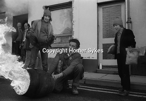 Tar Barrel Rolling, Ottery St Mary, Devon, England 1973. November 5th. Flaming tar barrels are run through the street of the village during the night.These are children barrels.Adult barrels are larger and later in the evening.