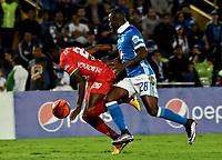 BOGOTA - COLOMBIA - 20 – 05 - 2017: Duvier Riascos (Der.) jugador de Millonarios disputa el balón con Oscar Cabezas (Izq.) jugador de Patriotas F.C., durante partido de la fecha 19 entre Millonarios y por la Liga Aguila I-2017, jugado en el estadio Nemesio Camacho El Campin de la ciudad de Bogota. / Duvier Riascos (R) player of Millonarios vies for the ball with Oscar Cabezas (L) player of Patriotas F.C., during a match of the date 19th between Millonarios and Patriotas F.C., for the Liga Aguila I-2017 played at the Nemesio Camacho El Campin Stadium in Bogota city, Photo: VizzorImage / Luis Ramirez / Staff.