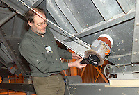 David Armitage measuring the air flow of a cooling fan.