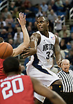January 21, 2012:   Nevada Wolf Packguard Malik Story passes behind the back of the Fresno State Bulldogs defender during their NCAA basketball game played at Lawlor Events Center on Saturday night in Reno, Nevada.