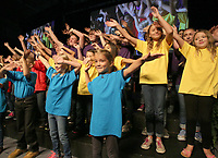 NWA Democrat-Gazette/DAVID GOTTSCHALK   Fayetteville Public Schools' elementary students dance Friday, August 11, 2017, with the Fayetteville High School Encore Choir during the opening of the Imagine the Possibilities Fayetteville Public Schools Convocation 2017 inside the high school arena on the campus. The convocation included performances with the high school band, keynote speaker Matthew Wendt, superintendent of schools followed by the 30th annual Fayetteville Education Expo.