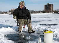 John Fraser, of Sarnia, Ice fishing on Sarnia Bay
