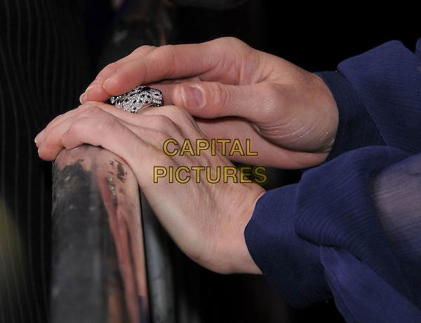 RENEE ZELLWEGER'S HANDS.The Universal Pictures World Premiere of Leatherheads held at The Grauman's Chinese Theatre in Hollywood, California, USA..March 31st, 2008      .ring jewellery jewelry .CAP/DVS.©Debbie VanStory/Capital Pictures.