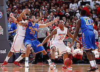 Ohio State Buckeyes guard Lenzelle Smith Jr. (32) guards Delaware Blue Hens guard Devon Saddler (10) as Ohio State Buckeyes center Trey McDonald (55) keeps Delaware Blue Hens forward Carl Baptiste (33) out of the paint during the second half of the NCAA men's basketball game at Value City Arena on Wednesday, December 18, 2013. Ohio State beat Delaware, 76-64. (Columbus Dispatch photo by Jonathan Quilter)