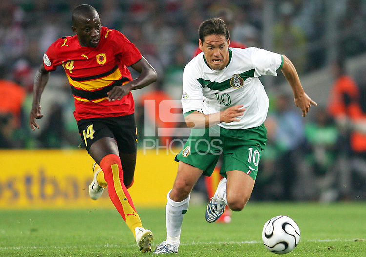 Guillermo Franco (10) of Mexico races away from Mendonca (14) of Angola.Mexico and Angola played to a 0-0 tie in their FIFA World Cup Group D match at FIFA World Cup Stadium, Hanover, Germany, June 16, 2006.