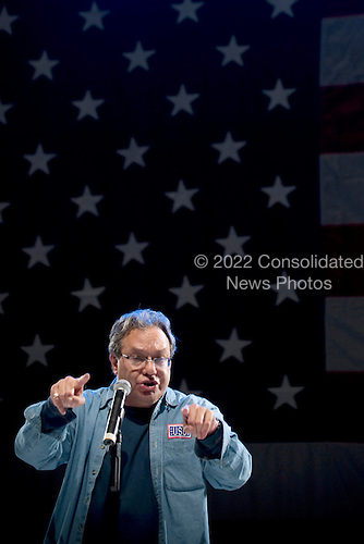 Ramstein AFB, Germany - December 16, 2008 -- Comedian Lewis Black performs for service members during the 2008 USO Holiday Tour stop at Ramstein Air Force Base, Germany on Tuesday, December 16, 2008. Tour host United States Navy Admiral Mike Mullen, chairman of the Joint Chiefs of Staff and his wife Deborah were joined by comedians Kathleen Madigan and John Bowman; actress Tichina Arnold; American Idol contestant and country musician Kellie Pickler and Grammy award winning musician Kid Rock on the tour bringing joy to service members and their families stationed overseas. .Credit: Chad J. McNeeley - DoD via CNP