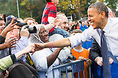 United States President Barack Obama greets supporters during a campaign event at George Mason University in Fairfax, Virginia on Friday, October 19, 2012..Credit: Kristoffer Tripplaar  / Pool via CNP